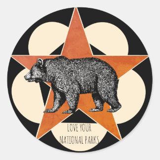 Sticker Rond Aimez votre ours de montagne de parcs nationaux