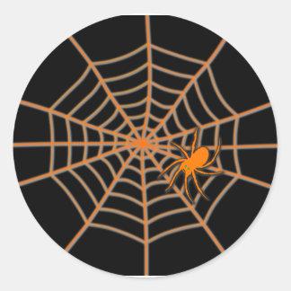 Sticker Rond Araignée et Web oranges sur le noir