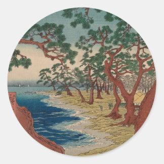 Sticker Rond Arbres tordus par le rivage