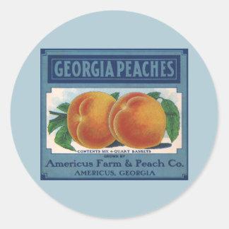 Sticker Rond Art vintage d'étiquette de caisse de fruit, pêches