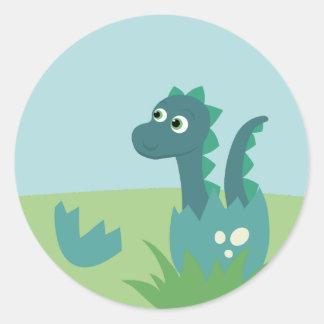 Sticker Rond Bébé de dinosaure dans l'autocollant d'oeufs