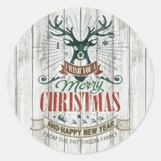 Sticker Rond Bois rustique de Joyeux Noël et de renne de