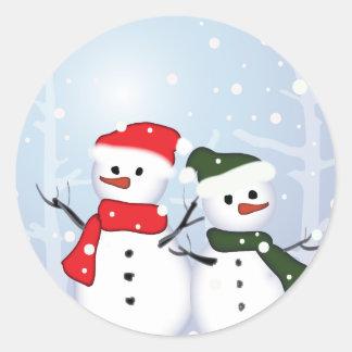 Sticker Rond Bonhomme de neige du pays des merveilles d'hiver