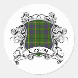 Sticker Rond Bouclier de tartan de Taylor