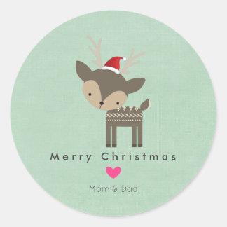 Sticker Rond Cerfs communs de Noël dans un casquette rouge de