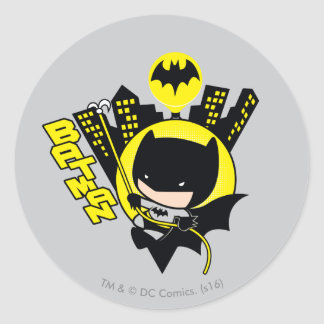 Sticker Rond Chibi Batman mesurant la ville