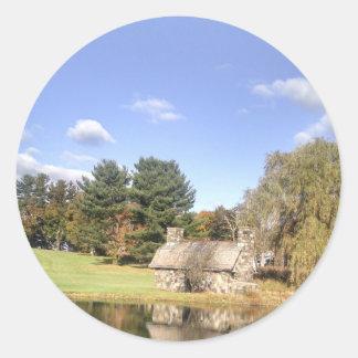 Sticker Rond Cottage sur un lac