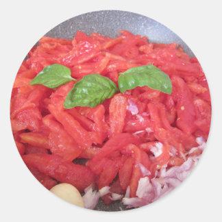 Sticker Rond Cuisson de la sauce tomate faite maison