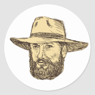 Sticker Rond Dessin barbu de tête de cowboy