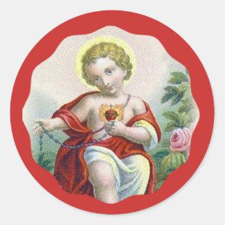 Sticker Rond Enfant sacré Jésus de coeur tenant le chapelet