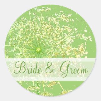 Sticker Rond Fleur sauvage élégante avec des remous épousant