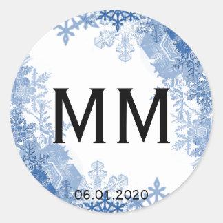 Sticker Rond Flocons de neige bleus sur l'autocollant blanc de