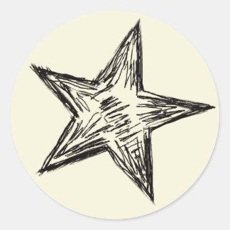Sticker Rond Forme noire d'étoile esquissée par crayon