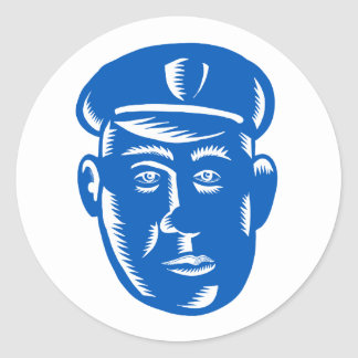 Sticker Rond Gravure sur bois en tête de policier