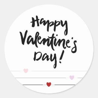 Sticker Rond Heureuse Sainte-Valentin avec des coeurs sur des