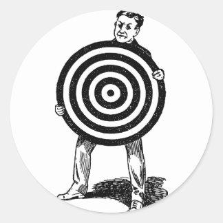 Sticker Rond Homme tenant la cible