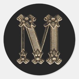 Sticker Rond Initiale ou monogramme d'or de la lettre M sur le