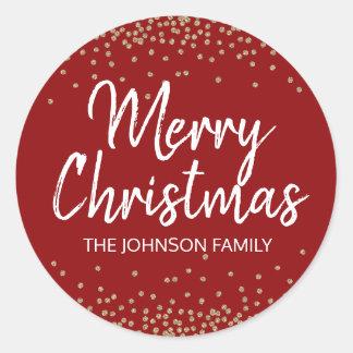 Sticker Rond Joyeux Noël d'or de confettis rouge-foncé de