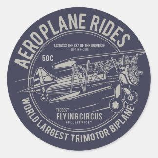 Sticker Rond L'avion monte des cadeaux d'avion du cirque   de