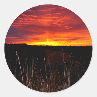 Sticker Rond Le feu dans le ciel au lever de soleil