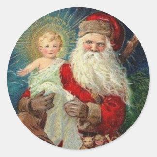 Sticker Rond Le père noël tenant le bébé Jésus