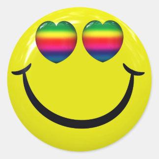 Sticker Rond Le visage souriant heureux avec l'arc-en-ciel