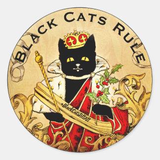 Sticker Rond Les chats noirs ordonnent le monde royal