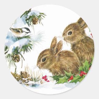Sticker Rond Les lapins et l'oiseau apprécient la neige