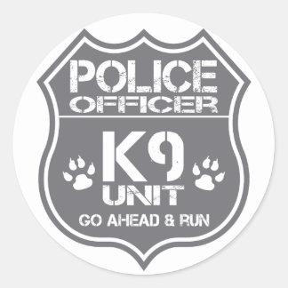 Sticker Rond L'unité du policier K9 vont en avant course