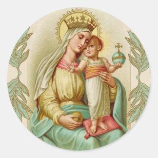 Sticker Rond Mère bénie tenant le globe de Jésus d'enfant