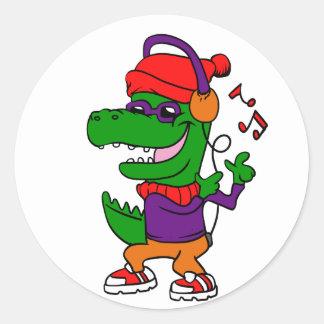 Sticker Rond Musique et danse de écoute de dinosaure