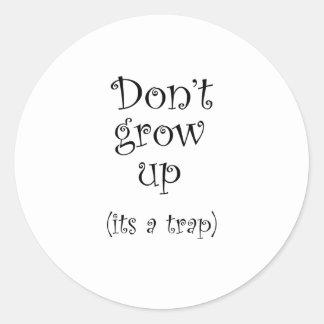 Sticker Rond Ne grandissez pas, il est un piège !