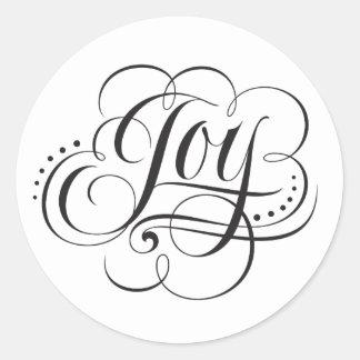 Sticker Rond Noël de joie au lettrage de calligraphie du monde