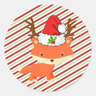 Sticker Rond Noël de port de casquette de Père Noël de renne de