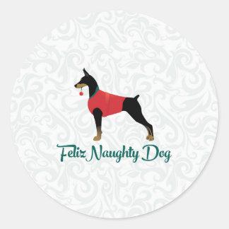 Sticker Rond Noël vilain de chien de Feliz de Pinscher de