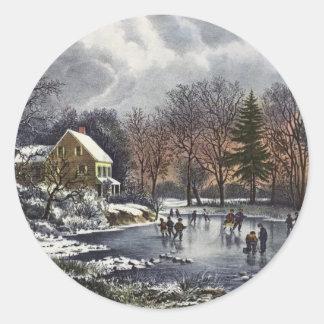 Sticker Rond Noël vintage, premiers patineurs d'hiver sur