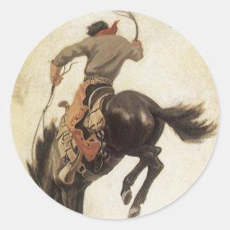 Sticker Rond Occidental vintage, cowboy sur un cheval