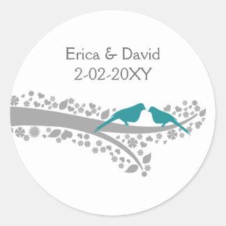 Sticker Rond perruches bleues d'arbre fantaisie épousant des