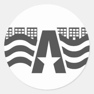Sticker Rond Premier nom de lettre - un paysage de ville avec