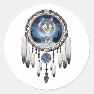Sticker Rond Receveur rêveur avec l'arrière - plan de loup