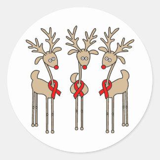 Sticker Rond Renne rouge de ruban (maladie cardiaque et course)
