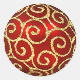 Sticker Rond Rouge avec des remous d'or
