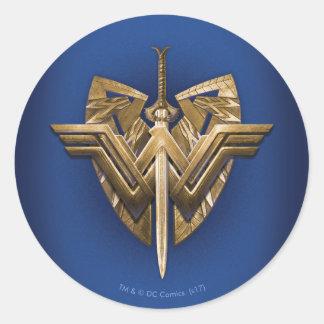 Sticker Rond Symbole de femme de merveille avec l'épée de la