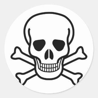 Sticker Rond Symbole de la mort de crâne et d'os croisés