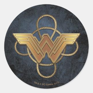 Sticker Rond Symbole d'or de femme de merveille au-dessus de