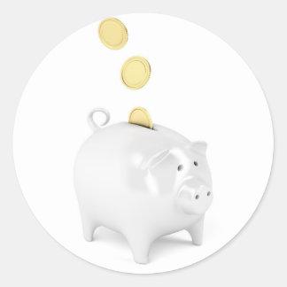 Sticker Rond Tirelire avec les pièces de monnaie d'or