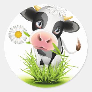 Sticker Rond Vache du Holstein dans l'herbe
