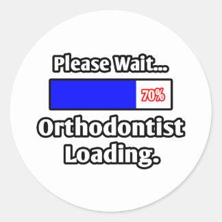 Sticker Rond Veuillez attendre… le chargement d'orthodontiste