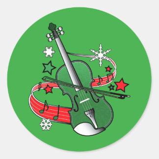 Sticker Rond Violon de vacances avec des notes et des flocons