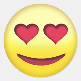 Sticker Rond Visage de sourire avec l'emoji drôle de yeux en